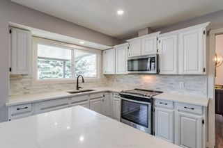 Photo 11: 884 Coach Side Crescent SW in Calgary: Coach Hill Detached for sale : MLS®# A1105957