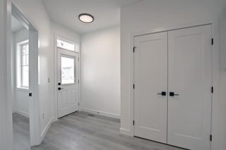 Photo 3: 126 Creekside Way SW in Calgary: C-168 Detached for sale : MLS®# A1144468