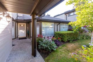 Photo 2: 107 16080 82 Avenue in Surrey: Fleetwood Tynehead Townhouse for sale : MLS®# R2602077