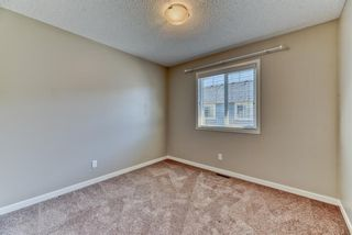 Photo 18: 539 Panatella Walk NW in Calgary: Panorama Hills Row/Townhouse for sale : MLS®# A1125854
