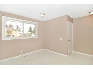 Photo 6: 409 RANCHVIEW Court NW in CALGARY: Ranchlands Residential Attached for sale (Calgary)  : MLS®# C3554095