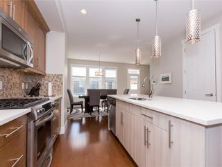 Photo 9: 460 QUARRY PARK Boulevard SE in Calgary: Douglasdale/Glen Row/Townhouse for sale : MLS®# C4236321