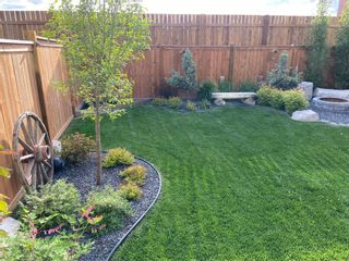 Photo 49: 207 Kinniburgh Road: Chestermere Semi Detached for sale : MLS®# A1057912