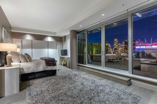 Photo 5: 1511 ATHLETES WAY in VANCOUVER: Condo for sale