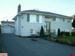 Photo 1: 9297 134TH Street in Surrey: Queen Mary Park Surrey House for sale : MLS®# F1009105