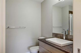 Photo 24: 102 501 RIVER HEIGHTS Drive: Cochrane Row/Townhouse for sale : MLS®# C4266118