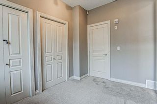 Photo 15: 7 124 Rockyledge View NW in Calgary: Rocky Ridge Row/Townhouse for sale : MLS®# A1111501