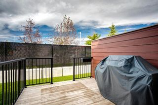 Photo 25: 15 West Coach Manor SW in Calgary: West Springs Row/Townhouse for sale : MLS®# A1100327