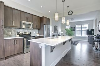 Photo 18: 444 Quarry Way SE in Calgary: Douglasdale/Glen Row/Townhouse for sale : MLS®# A1094767
