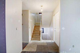 Photo 5: 132 Woodglen Way SW in Calgary: Woodbine Detached for sale : MLS®# A1134338