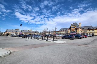 Photo 45: 444 Quarry Way SE in Calgary: Douglasdale/Glen Row/Townhouse for sale : MLS®# A1094767