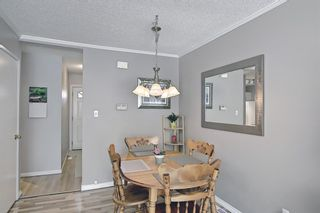 Photo 8: 787 Kingsmere Crescent SW in Calgary: Kingsland Row/Townhouse for sale : MLS®# A1108605