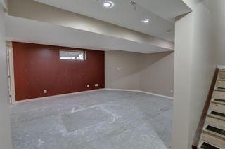 Photo 44: 128 Rainbow falls Grove E: Chestermere Duplex for sale : MLS®# A1154026