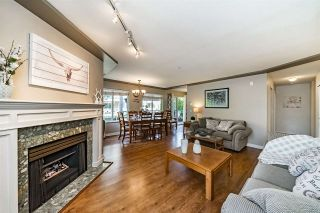 """Photo 2: 209 20443 53 Avenue in Langley: Langley City Condo for sale in """"Countryside Estates"""" : MLS®# R2303948"""