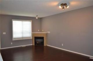 Photo 3: 92 Panamount Drive NW in Calgary: Panorama Hills Row/Townhouse for sale : MLS®# A1122234