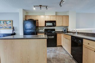 Photo 5: 85 TUSCANY Court NW in Calgary: Tuscany Row/Townhouse for sale : MLS®# C4243968