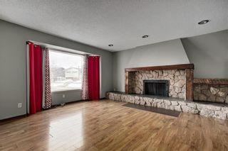 Photo 4: 304 QUEEN ANNE Way SE in Calgary: Queensland House for sale : MLS®# C4178496