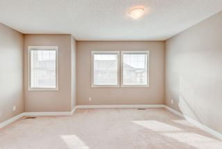 Photo 13: 100 28 Heritage Drive: Cochrane Row/Townhouse for sale : MLS®# A1076913