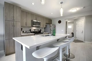 Photo 4: 403 Sunrise View: Cochrane Semi Detached for sale : MLS®# C4301233