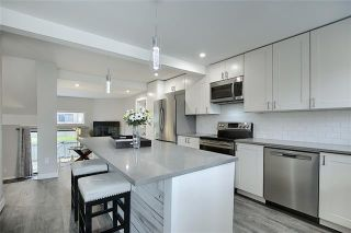 Photo 6: 18 23 GLAMIS Drive SW in Calgary: Glamorgan Row/Townhouse for sale : MLS®# C4293162