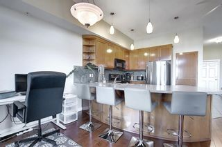 Photo 7: 6401 14 HEMLOCK Crescent SW in Calgary: Spruce Cliff Apartment for sale : MLS®# A1036904