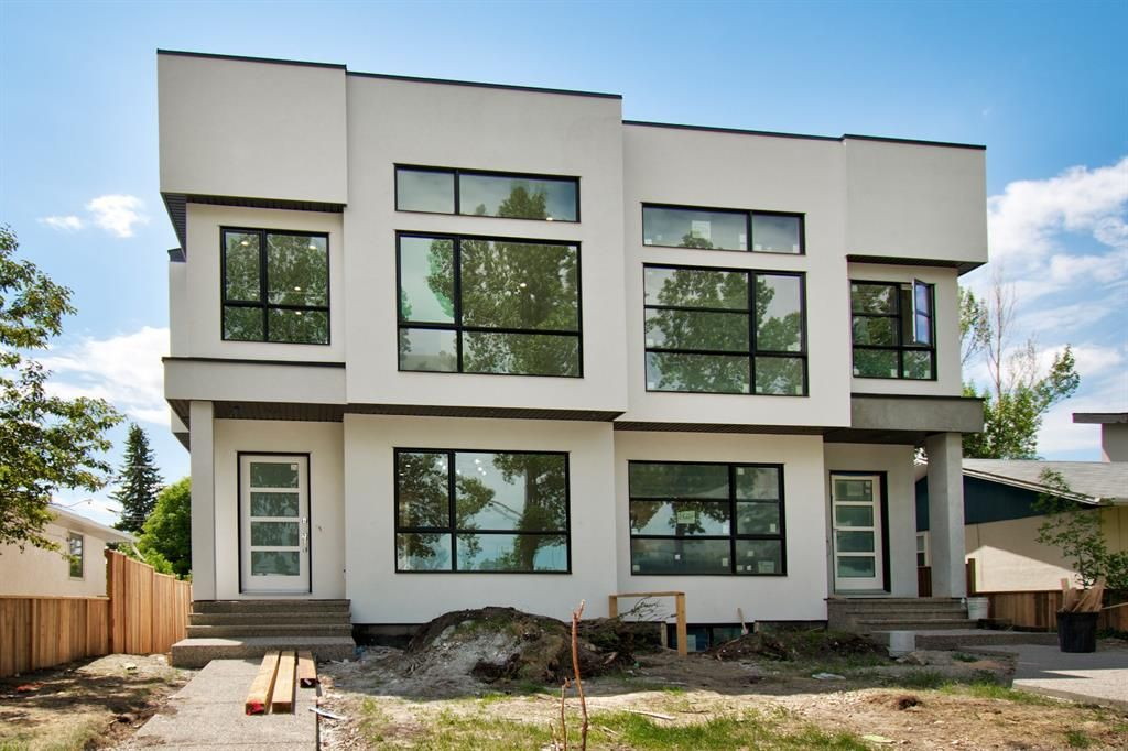 Main Photo: 2409 52 Avenue SW in Calgary: North Glenmore Park Semi Detached for sale : MLS®# A1123926