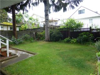 Photo 7: 5325 MCKINNON Street in Vancouver: Collingwood VE House for sale (Vancouver East)  : MLS®# V1028861