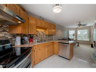 """Photo 6: 208 5375 205 Street in Langley: Langley City Condo for sale in """"GLENMONT PARK"""" : MLS®# R2295267"""