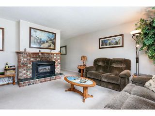 Photo 2: 9211 PRINCE CHARLES Boulevard in Surrey: Queen Mary Park Surrey House for sale : MLS®# F1409362