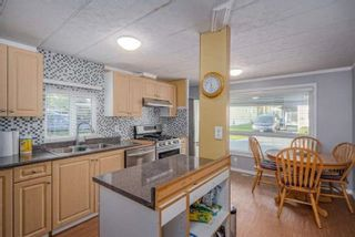 """Photo 4: 182 7790 KING GEORGE Boulevard in Surrey: East Newton Manufactured Home for sale in """"CRISPEN BAYS"""" : MLS®# R2591510"""
