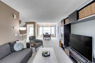 Photo 4: 81 Coachway Gardens SW in Calgary: Coach Hill Row/Townhouse for sale : MLS®# A1147900