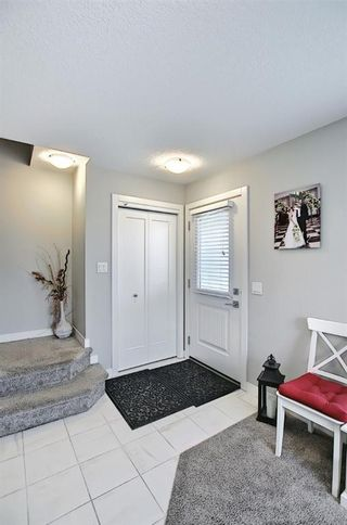 Photo 9: 111 Evanscrest Gardens NW in Calgary: Evanston Row/Townhouse for sale : MLS®# A1135885