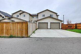 Photo 45: 102 Clydesdale Way: Cochrane Row/Townhouse for sale : MLS®# A1117864