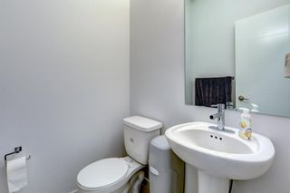 Photo 14: 135 NOLANCREST Common NW in Calgary: Nolan Hill Row/Townhouse for sale : MLS®# A1105271