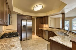 Photo 7: 7 Laneham Place SW in Calgary: North Glenmore Park Detached for sale : MLS®# A1097767