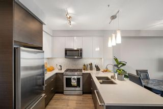 Photo 7: 1307 95 Burma Star Road SW in Calgary: Currie Barracks Apartment for sale : MLS®# A1114501