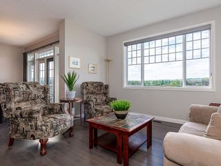 Photo 4: 46 RIVIERA Way: Cochrane Row/Townhouse for sale : MLS®# C4281559