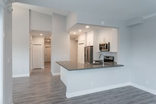 "Photo 9: 504 2229 ATKINS Avenue in Port Coquitlam: Central Pt Coquitlam Condo for sale in ""Downtown Pointe"" : MLS®# R2553513"