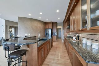 Photo 21: 32 coulee View SW in Calgary: Cougar Ridge Detached for sale : MLS®# A1117210