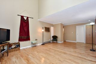 """Photo 3: 7403 TAMARIND Drive in Vancouver: Champlain Heights Townhouse for sale in """"THE UPLANDS"""" (Vancouver East)  : MLS®# R2426145"""