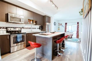 Photo 1: 29 13636 81A Avenue in Surrey: Bear Creek Green Timbers Townhouse for sale : MLS®# R2590197