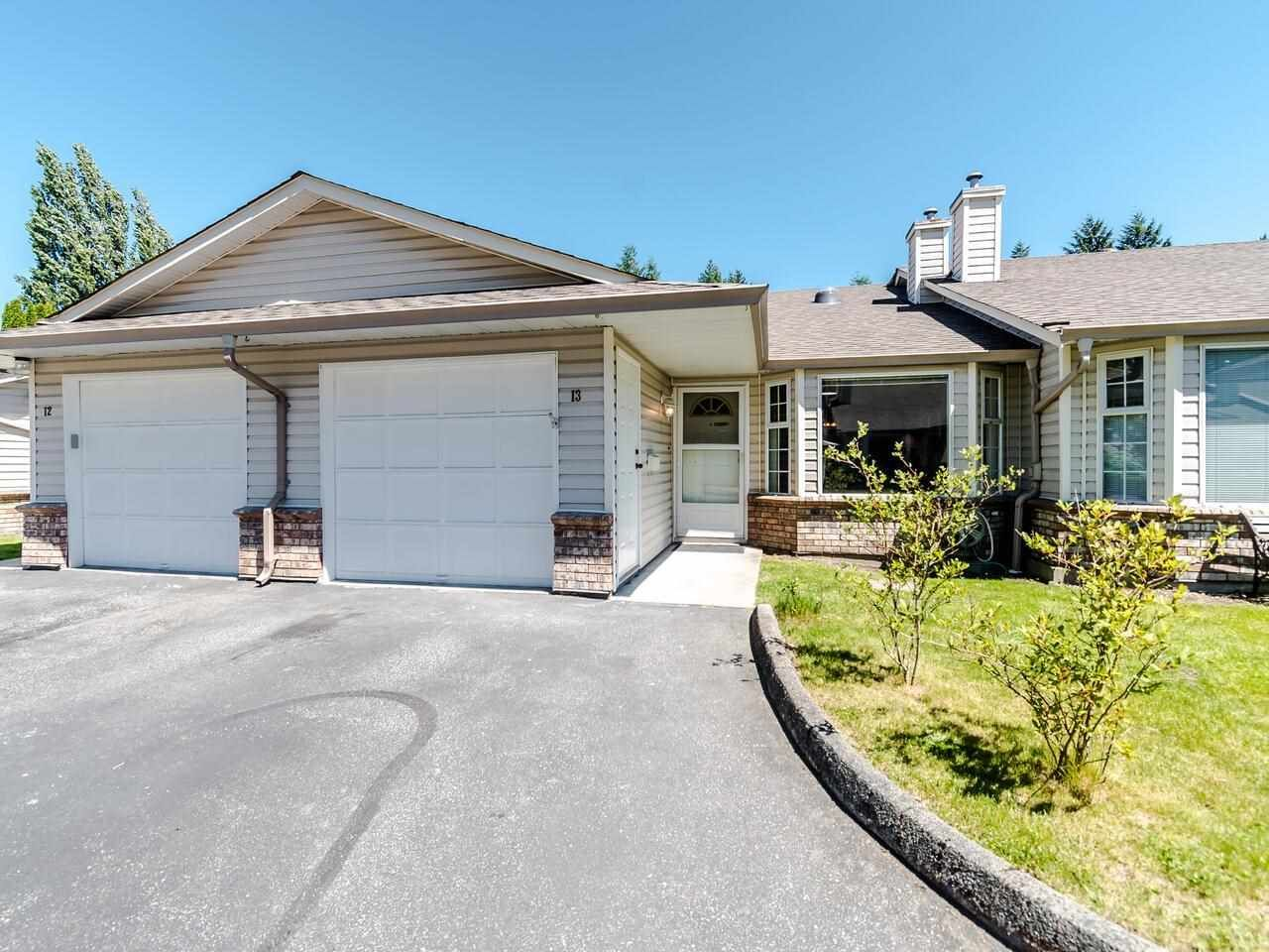 Rancher Style Townhome with attached Single garage and parking on the driveway