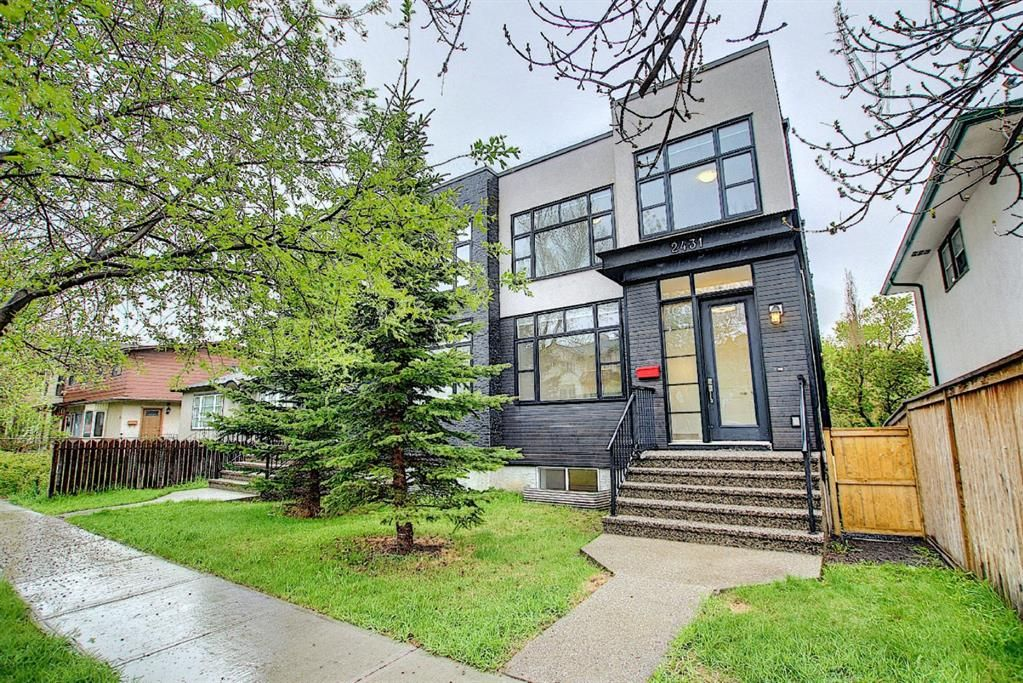 Main Photo: 2431 7 Avenue NW in Calgary: West Hillhurst Semi Detached for sale : MLS®# A1112979