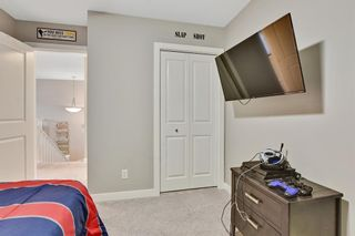 Photo 26: 207 Kinniburgh Road: Chestermere Semi Detached for sale : MLS®# A1057912
