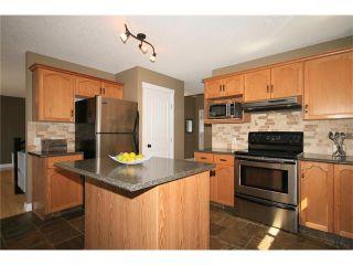 Photo 12: 5 WEST TERRACE Crescent: Cochrane House for sale : MLS®# C4048617