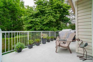 "Photo 19: 206 16031 82 Avenue in Surrey: Fleetwood Tynehead Townhouse for sale in ""SPRINGFIELD"" : MLS®# R2411898"