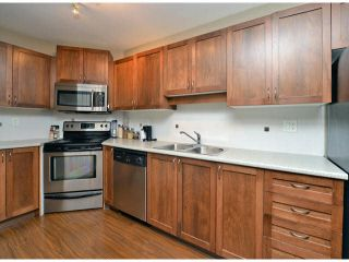 """Photo 5: 118 32725 GEORGE FERGUSON Way in Abbotsford: Abbotsford West Condo for sale in """"Uptown"""" : MLS®# F1417772"""