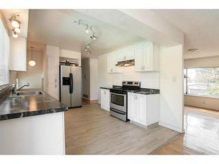 Photo 2: 2027 KAPTEY AV in Coquitlam: Cape Horn House for sale : MLS®# V1117755