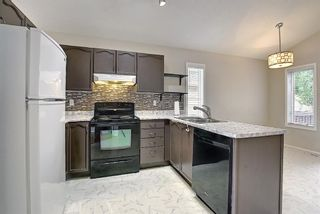 Photo 4: 110 Coverton Close NE in Calgary: Coventry Hills Detached for sale : MLS®# A1119114