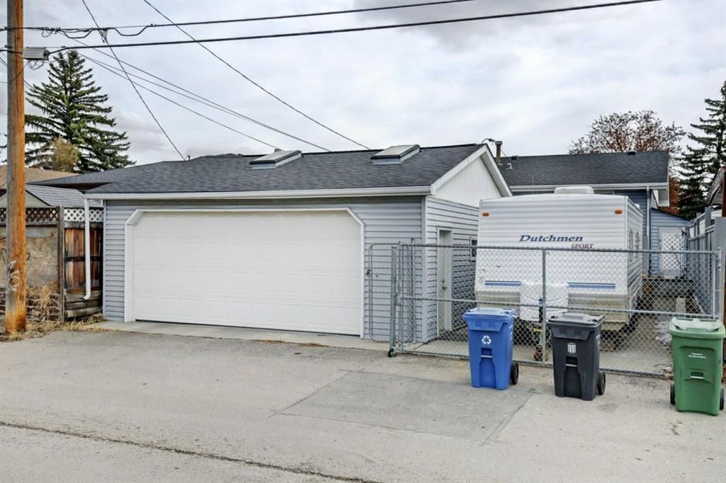 Oversized Double detached garage with RV Parking!
